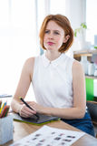 Thoughtful hipster businesswoman with a digital drawing tablet Stock Photo