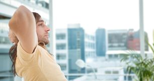 Thoughtful hipster sitting in office Royalty Free Stock Photos