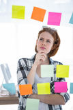 Thoughtful hipster woman brainstorming over notes Royalty Free Stock Image
