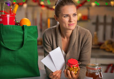 Thoughtful housewife with christmas shopping bag Royalty Free Stock Photography