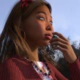 Thoughtful Indonesian Girl outdoors stock image