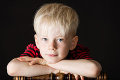 Thoughtful intense attractive little blond boy royalty free stock photos
