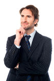 Thoughtful isolated business leader Royalty Free Stock Photography