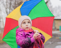 Thoughtful ittle girl with umbrella Royalty Free Stock Image