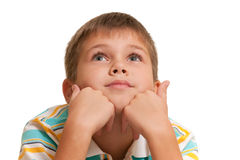 Thoughtful kid with great eyelashes Stock Photos