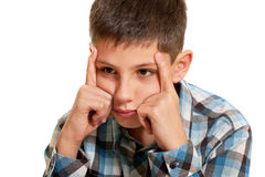 Thoughtful kid holding his head with his fingers Stock Image