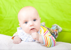 The thoughtful kid lies on a pillow. Royalty Free Stock Images