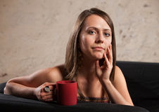 Thoughtful Lady with Cup Royalty Free Stock Photos