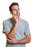 Thoughtful latin man Stock Photography