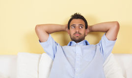 Thoughtful latin man on a sofa Stock Image