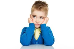 Thoughtful little boy in blue cardigan Stock Photo