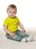 Thoughtful little boy on the carpet Royalty Free Stock Photography