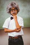 Thoughtful little boy dressed as senior teacher. Portrait of thoughtful little boy dressed as senior teacher royalty free stock images