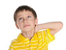 Thoughtful little boy looks up Stock Images
