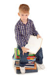 Thoughtful little boy with open book Stock Photo
