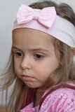 Thoughtful little girl. Serious little girl with pink bow. Portrait Royalty Free Stock Images