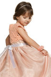 Thoughtful little girl in a ball gown Royalty Free Stock Photos