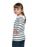 Thoughtful little girl looks back Stock Photos