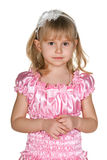 Thoughtful little girl in pink Royalty Free Stock Image