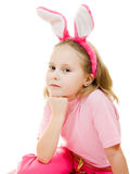Thoughtful little girl with pink ears bunny Stock Image