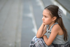 Thoughtful little girl Stock Images