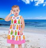 Thoughtful little girl posted a shell to your ear Royalty Free Stock Photo
