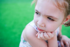 Thoughtful little girl and resigned. Royalty Free Stock Image