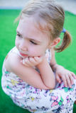 Thoughtful little girl and resigned. Royalty Free Stock Images