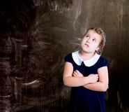 Thoughtful girl against chalkboard royalty free stock photo