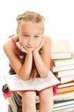 Thoughtful little schoolgirl Stock Image