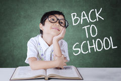 Thoughtful little student back to school Royalty Free Stock Photos