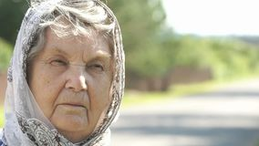 Thoughtful look of serious elderly woman. Close-up stock video