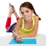 Thoughtful Looking Girl Drawing Royalty Free Stock Images