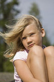 Thoughtful looking young girl outdoors Royalty Free Stock Photography