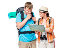 Thoughtful lost tourists looking at a map on a white Royalty Free Stock Photography