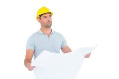 Thoughtful male architect holding blueprint Stock Photos