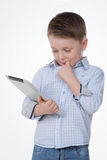 Thoughtful male kid on white background Stock Photography