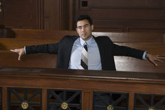 Thoughtful Male Lawyer Sitting In Courtroom Stock Image
