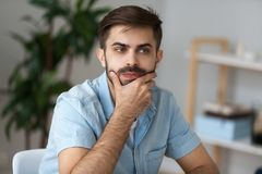Thoughtful male look in distance making decision royalty free stock photos