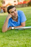 Thoughtful male student Royalty Free Stock Images