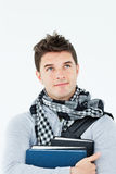 Thoughtful male student holding books Royalty Free Stock Images