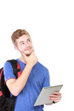Thoughtful male student portrait using tablet Royalty Free Stock Images