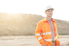 Thoughtful male supervisor looking away at construction site Stock Images