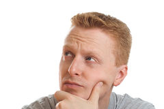 Thoughtful man. Portrait of a thoughtful man isolated on pure white background royalty free stock image