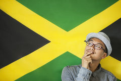 Thoughtful man against Jamaican flag royalty free stock photo