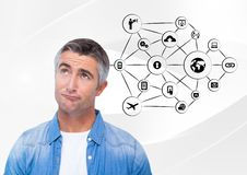 Thoughtful man and application icons Royalty Free Stock Image