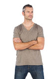 Thoughtful man with arms crossed Royalty Free Stock Photos