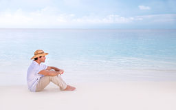 Thoughtful man on the beach Royalty Free Stock Images