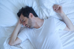 Thoughtful man cannot sleep because of insomnia Royalty Free Stock Photos