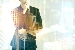 Thoughtful man on city background Royalty Free Stock Photos